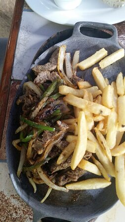Catarina, Nicaragua: Beef Fajita Plate served with rice and refried beans with option of french fries or baked potato or tajadas (plantains) or tortilla.