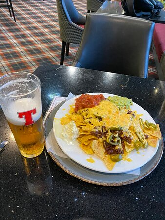 Nachos and a tasty pint of Tennents in the Balmoral Bar