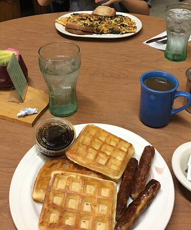 Fair Haven, VT: I don't know why'd I ever be 4 hours north of New York City again in my life, deep into Vermont---but I hope I get there again some day so I can have these waffles one more time.  And across the table is--ONE omelet.  One.  Lol.  Size of an aircraft carrier.