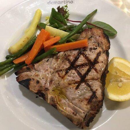 Nodillo di Vitello - Large grilled veal chop marinated in lemon juice & rosemary
