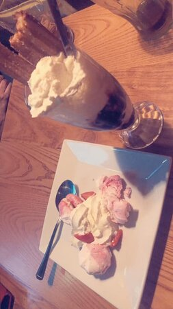 Castleton, UK: Meringue Kisses -  Mini rippled meringues with a light strawberry mousse filling Churros Chocolate Sundae - Delicious vanilla dairy Ice cream layered with brownie chunks and chocolate sauce. Topped with a whip of cream and warm churros coated in cinnamon sugar