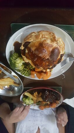 Beef and Ale pie in the Foreground, Lamb Shank opposite all veg and chips cooked fresh and tasted great.