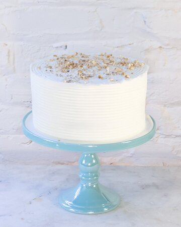 Italian Creme Cake || A perfect union!  The nutty flavor of local Georgia pecans & the sweet tropical note of coconut makes this cake extra scrumptious, layered with vanilla custard and iced with the cool taste of whipped cream.