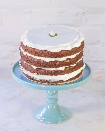 Chocolate Boyfriend Cake || For the tomboy in you!  Layers of rich fudgey chocolate cake sandwiched with perfectly pale pink buttercream icing, topped with a sugar rose.