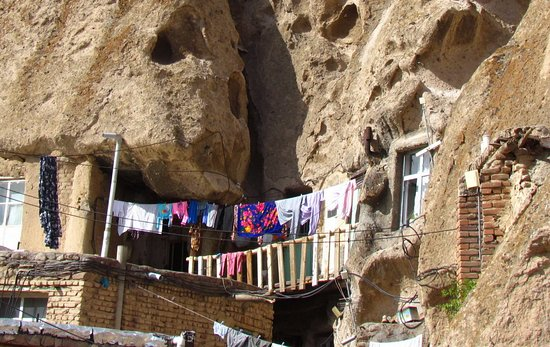 Kandovan is a village with houses dug in the rock 55 km south of Tabriz. This village is several thousand years old. Examples of such rock villages are Cappadocia in Turkey and Dakota in the United States, with the exception that the people of Kandovan still live in rock houses. Kandovan village is located at the foot of Sahand mountain and the conical rocky ridges of the village are the result of freezing of ash and volcanic material of Sahand mountain.