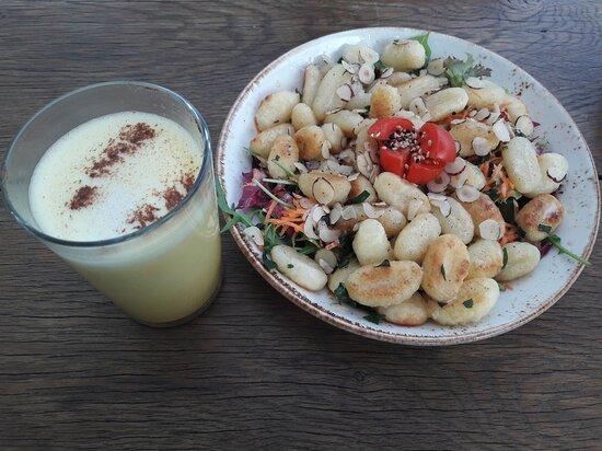 Golden milk & gnocchi with almonds & veggies