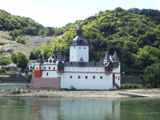 Kaub, Germany: Long time ago custom facilities looked like this. Castle Pfalzgrafenstein within the river Rhine was used to raise and collect customs from ships. Its main tower was boult in the 14th century.