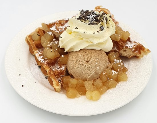 Sugar & Spice  hot waffle with one of our fluffy interior, crunchy exterior fresh cooked waffles,  spice apple and Cafe Latte gelato.