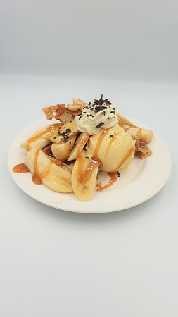 Banoffee hot waffle.  With banana and either Sea Salt Caramel or vanilla gelato, a caramel sauce topping and whipped cream, this waffle is sure to please!
