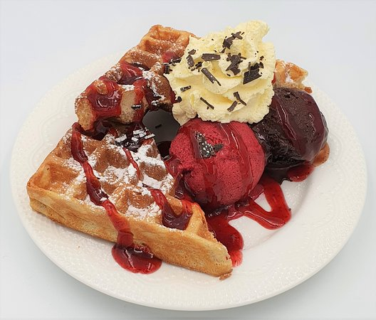 Double trouble.  Our freshly cooked hot waffle where you choose the gelato and the topping.  Made for you  as you wait.