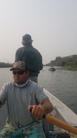 Fort Smith, MT : Bryen rowing the drift boat. Bighorn River Anglers.