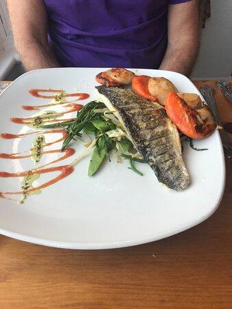 Sea Bass & King Scallops Sea Bass fillet on samphire green stir fry, seared king scallops & a herb butter sauce.