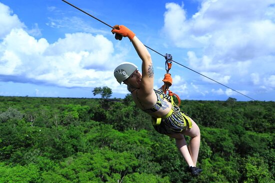 Cancun Adventure Tour at Selvatica: Zipline, Aerial Bridge, Buggy, Bungee Swing and Cenote Swim: Zipling