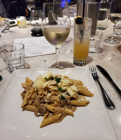 Mushroom Penna pasta tossed in truffle oil and topped with parmigiana regina