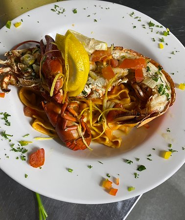 Half Lobster served with Aragosta sauce