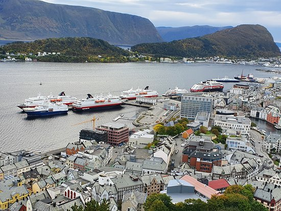 Alesund, Norway: View of several Hurtigruten Ships, still on standby in the south Ålesund habour.