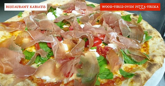 Thin and crispy pizza prepared fresh to order and baked in our Italian wood-fired oven.