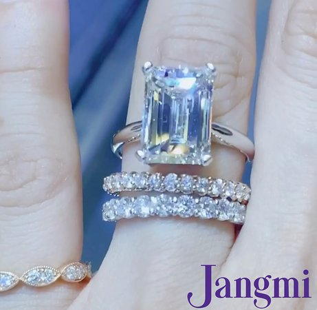 7ct Emerald cut on our platinum T- Tapered solitaire.