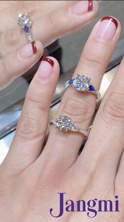 round brilliant on our love three stone with side pears. One setting has deep blue sapphires and the other with sparkling diamonds.