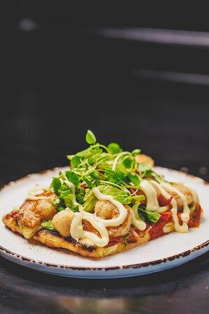 Naan Shellfish Pizza  Tiger Prawns, Scallops, Mozzarella, Tikka Masala, Red Onion, Bell Pepper, Aioli, Salad