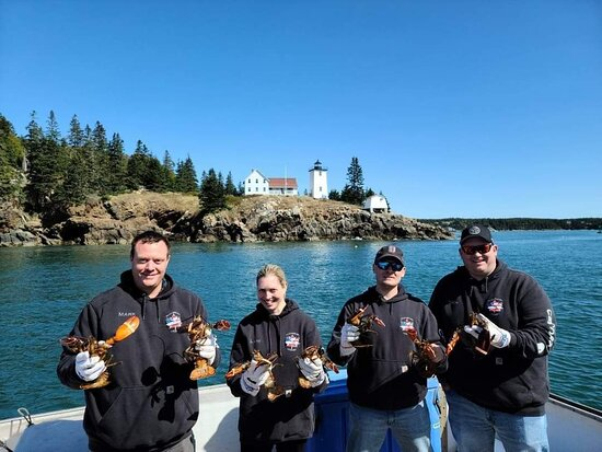 Swans Island, ME: Part of the crew from Sugarbush Armory celebrating the fresh catch!