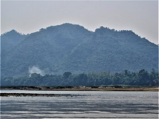 """Ban Pak-Ou, Laos: On the waters of iconic """"Mekong River"""" towards the """"Pak Ou Caves"""", near Luang Prabang in Laos."""