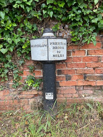 This milepost marker on the towpath next to the Trent & Mersey Canal indicates the number of miles from the centre of the village of Shardlow to Preston Brook, Liverpool. A journey of 92 miles by canal.