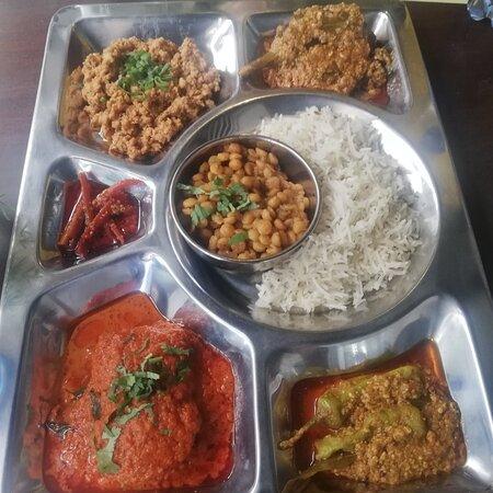 The Patio thali with bagharay baigun, tamatar ka kut,,qeema, mirchi ka salan, chanay ke daal ka halwa. Roast beef sandwiches and jalapeño chicken.