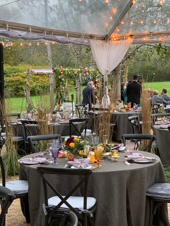 gorgeous table settings under the tent for this small wedding