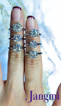 Round cut diamonds on our six prong and four prong solitaire settings.