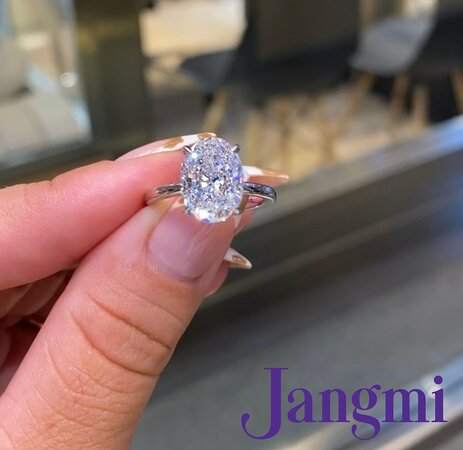 4ct oval cut diamond on our love fancy with under halo platinum solitaire.