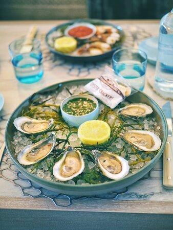 Oyster Selection Lemons, Key lime mignonette, Crushed ice, Garnish, Seaweed, Lemon capped