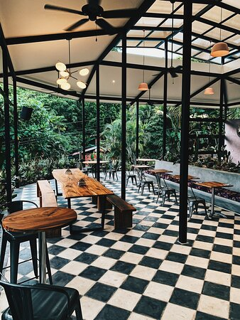 Wall to wall gardens  and checkered floors means you've  arrived