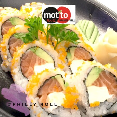 """""""Philly Roll"""": salmon, cream cheese & cucumber, topped with masago (roe)."""
