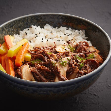 Slow Cooker Beef on Rice A Savoury Bowl Marination of Pulled Beef Korean Style in Crock Pot with Oyster Mushroom, Cucumber, Carrot, Spring Onion, Laid on Bed of Steamed Rice