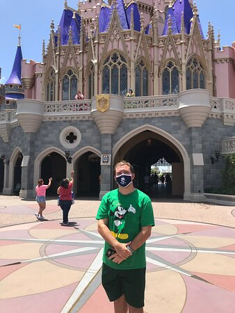 Celebrating my high school graduation in front of the Cinderella Castle at Disney World