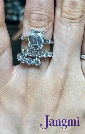 5ct Emerald cut on our three stone side baguette setting.