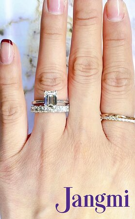 1.8ct Emerald cut on our love fancy solitaire paired with our love princess shared prong wedding band.