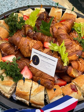 Tray of mini sandwiches on baguette and croissants
