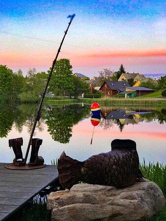 Moletai, Litauen: Fisherman's bots, fishing rod, fish