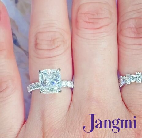 3.5ct radiant cut on our love fancy with under halo in platinum.