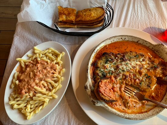 Chicken Parmesan with a side of pasta and garlic bread. Outstanding!