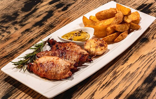 - Pork chop with butter,rosemary and garlic served with McCain wedges and mustard sauce 200/200g