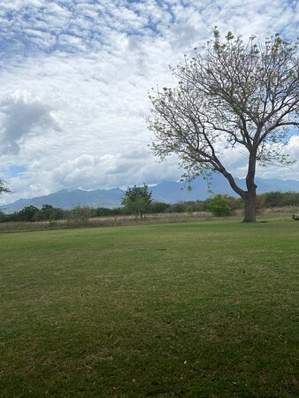 Great lawn for kids to play outside with a backdrop of the Uluguru mountains
