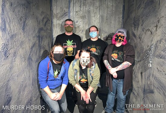 Five people posing against a creepy wall