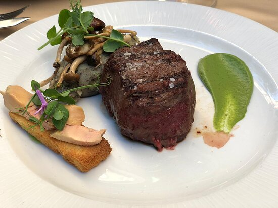 Lovely ox filet mignon, with truffle potato mousse, very smooth foie gras, and (what I believe to be) a rather acidic pea sauce at the side. Meat cooked to perfection - we asked for it to be blue.