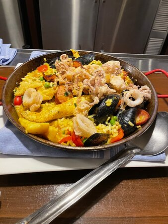 Chef Rolf S Sunday Special Paella So Delicious Filled With Mussles Shrimp Flounder Chicken And Sausage And Topped With Fried Calamari The Flavoring Was Out Of This World Picture Of Chef Rolf S New Florida Kitchen