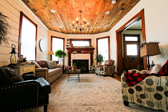Living room with grand fireplace