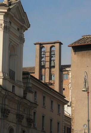Piazza Campitelli. The bell tower of the church and the fountain.