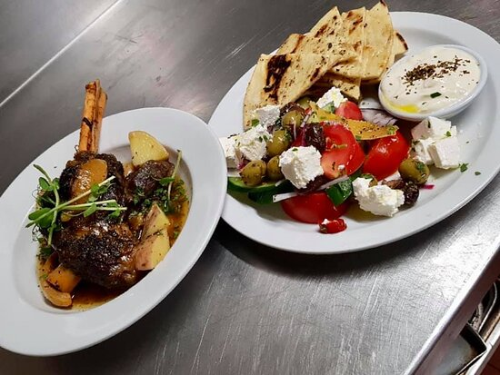 Greek style lamb shank served with Greek salad and toasted pitta bread